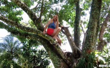 Girl On Treetop